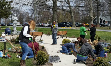A group of people planting shrubs.